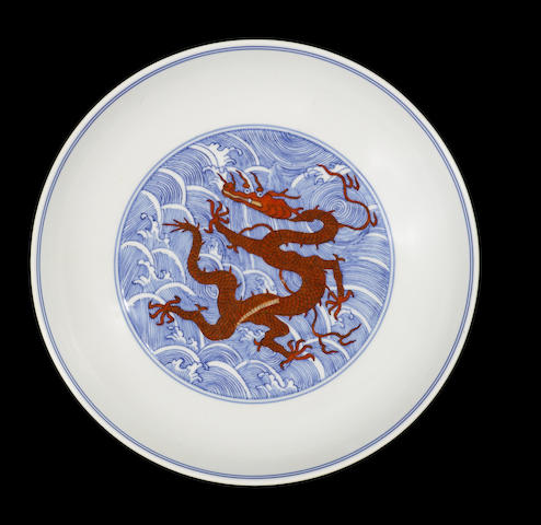 An iron-red and underglaze-blue 'dragon' dish Qianlong six-character seal mark and of the period