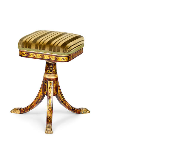 A Regency period faux rosewood and gilt decorated piano stool