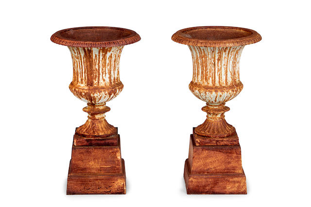A pair of cast iron urns French, late 19th century