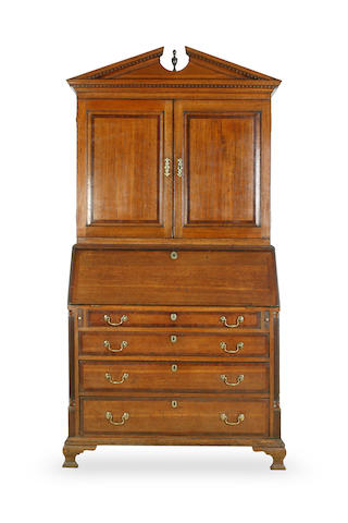 A George II oak and mahogany cross-banded bureau cabinet