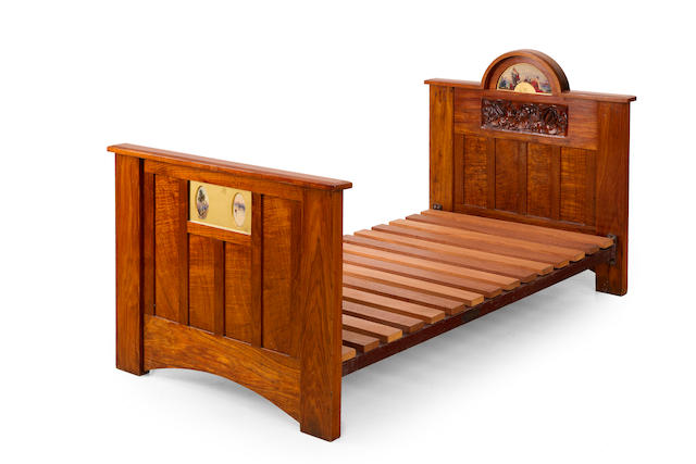 An Australian Arts and Crafts silky oak child's bed circa 1900
