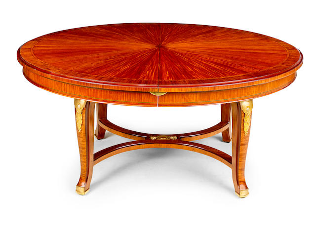 A Louis XVI style satinwood and gilt bronze mounted extension dining table with four leaves