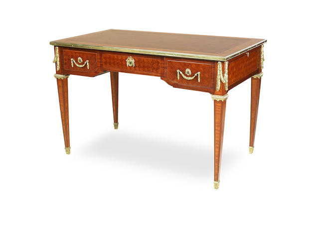 A Louis XVI style kingwood and satinwood parquetry bureau plat