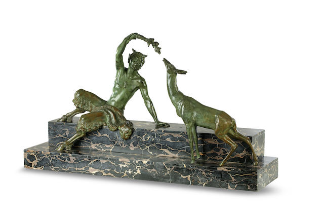 An Art Deco bronze figural group of satyr and a deer