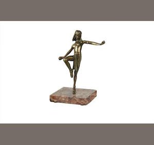 An Art Deco style bronze figure of an Egyptian dancer