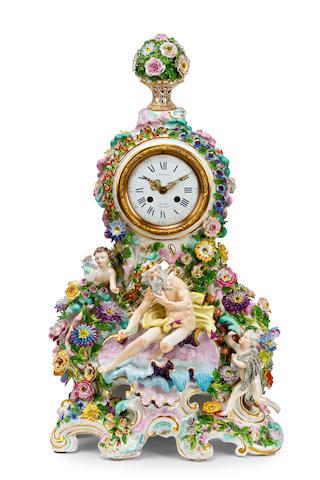 A Jacob Petit Meissen style porcelain figural flower-encrusted clock