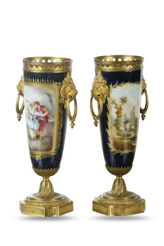 A pair of 19th century French porcelain vases with gilt mounts