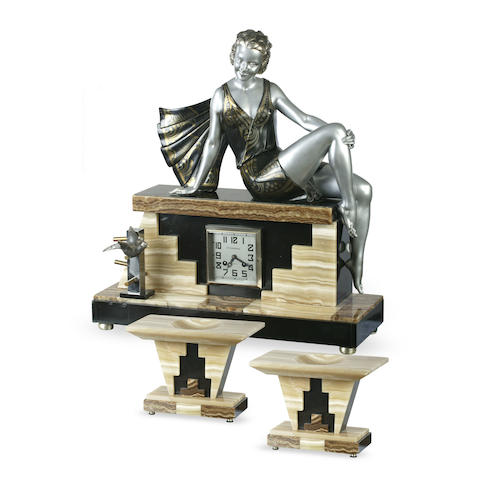 An large Art Deco painted spelter, marble and onyx figural clock garniature