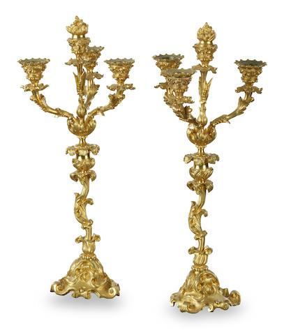 A pair of rococo style gilt bronze candlesticks/candelabra