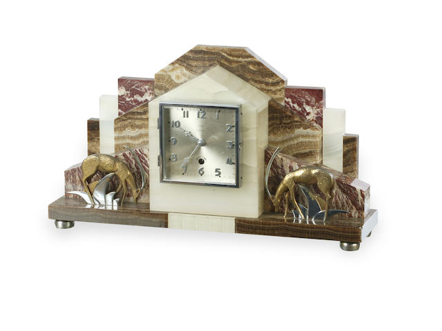 An Art Deco onyx and marble mantle clock