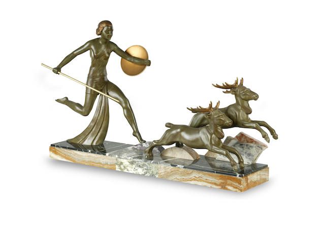 A patinated spelter figural group of Diana with deer