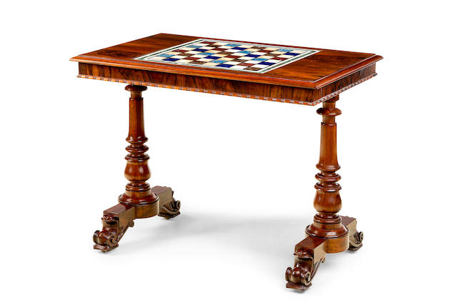 A George IV rosewood and specimen topped library table in the manner of Gillows