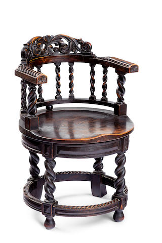 A late 19th century oak Captain's chair
