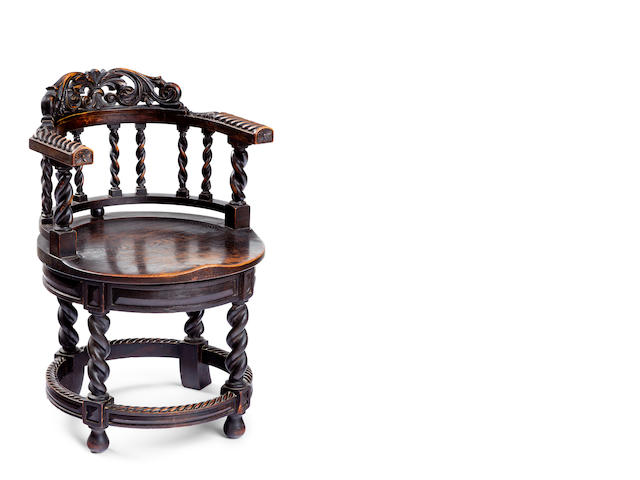 A late 19th century oak Captains chair
