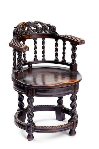 A late 19th century oak Captains chair