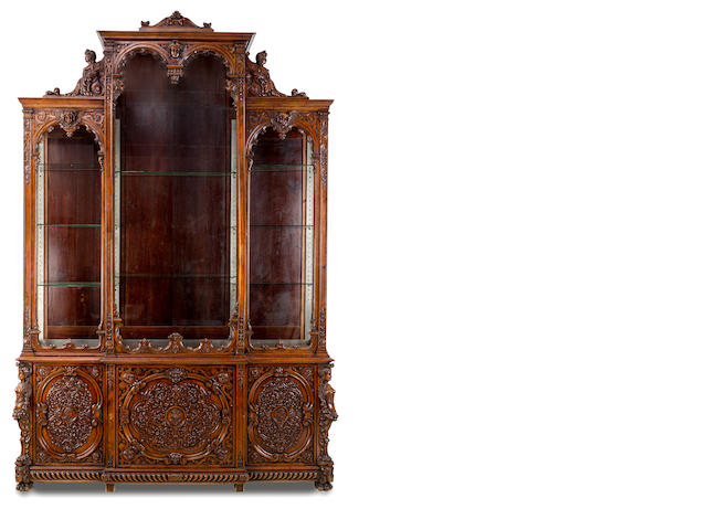 A large carved walnut breakfront bookcase