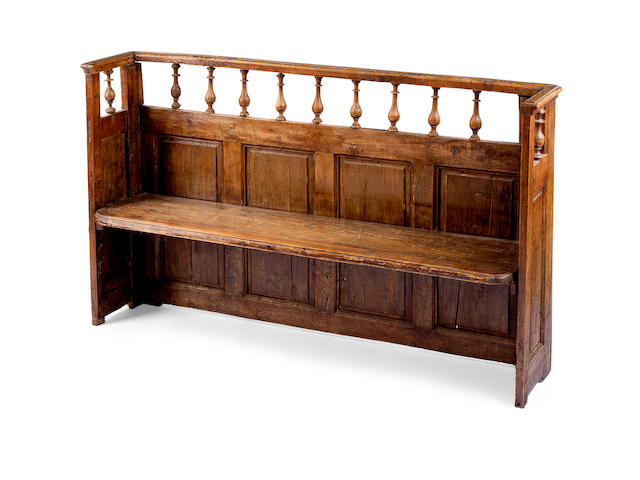An 18th century oak pew