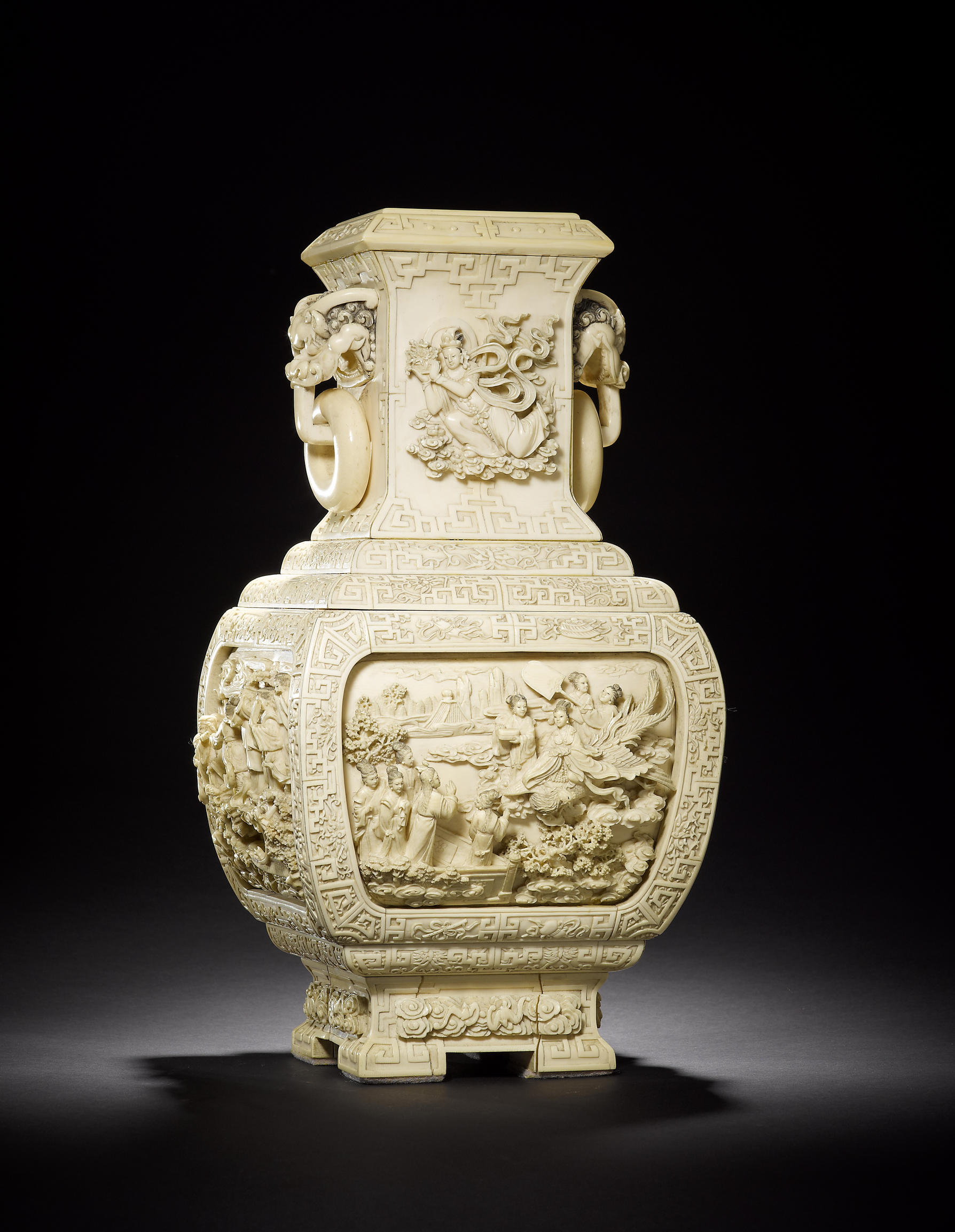 An extraordinary pair of large exquisitely carved ivory vases