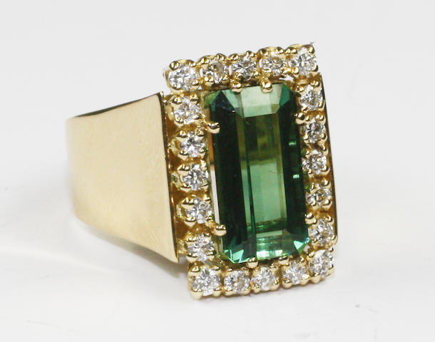 An 18ct gold green tourmaline and diamond cluster ring