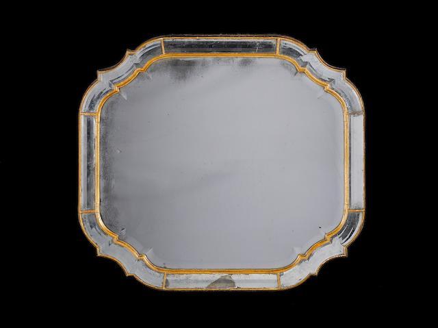 A Queen Anne giltwood marginal mirror