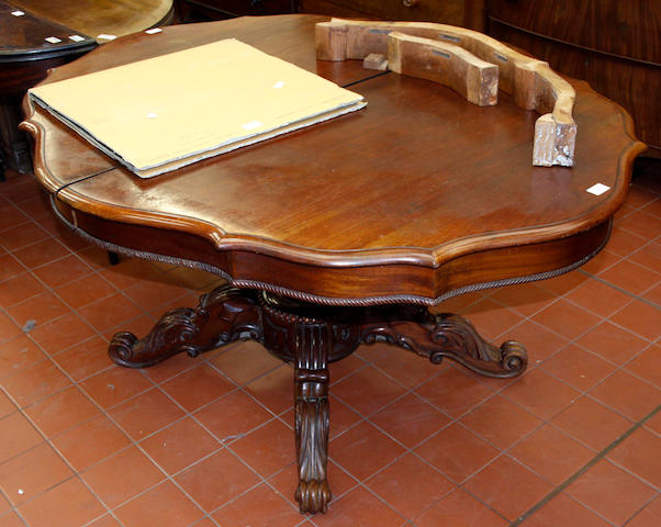 A mid-19th Century mahogany extending dining table,