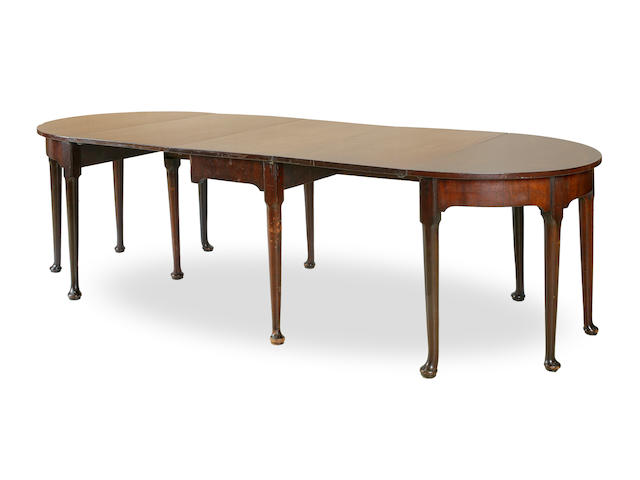 A George II style mahogany d-end drop leaf dining table