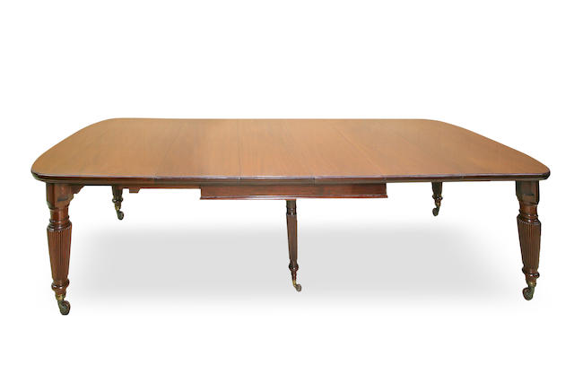 A large early Victorian mahogany extension dining table with five leaves