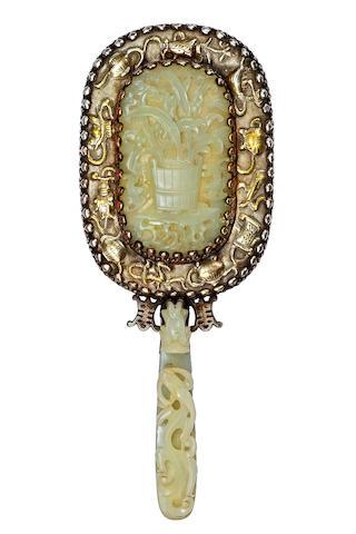 A Chinese hand mirror  circa 1900