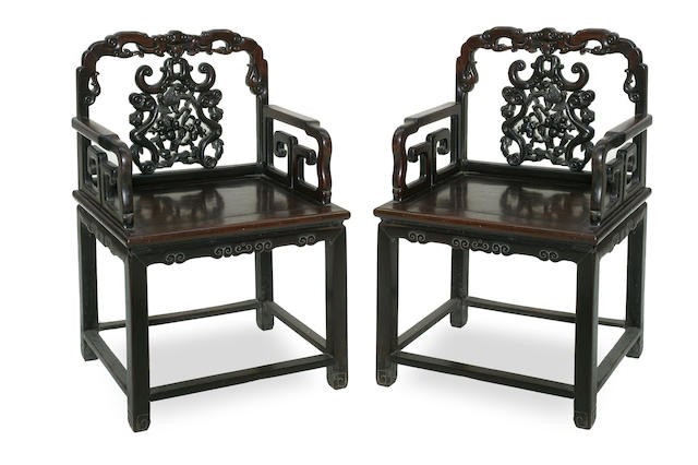 A pair of Chinese hongmu Ming style throne chairs