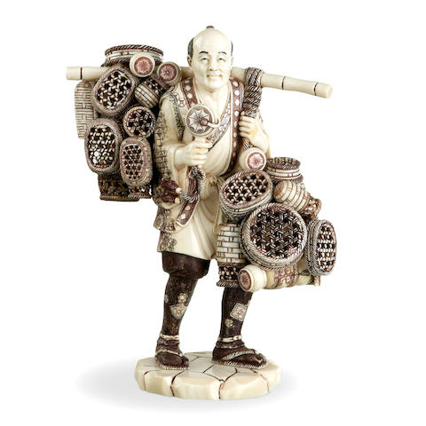 A Japanese ivory figure of a basket seller Meiji period late 19th century