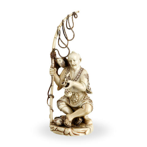 A Japanese ivory figure of a fisherman Meiji period.