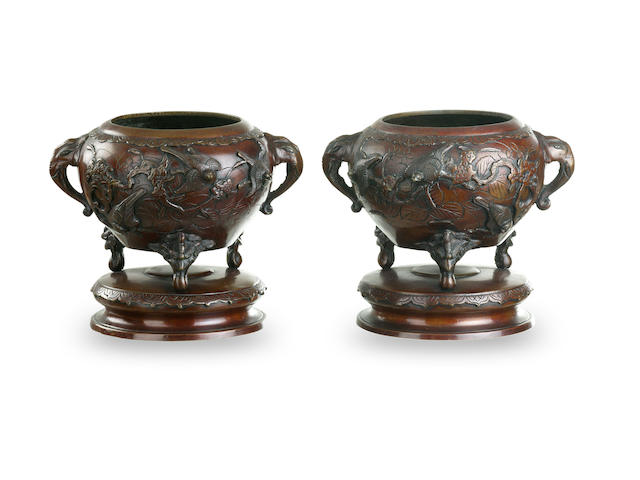 A pair of Japanese bronze tripod jardinieres late Meiji period