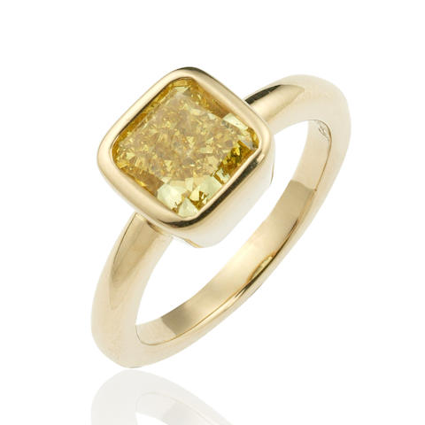 A 2.54 carat natural fancy vivid yellow diamond ring