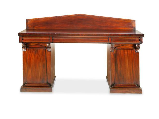 An Australian cedar pedestal sideboard
