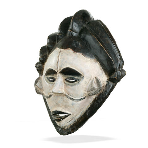 A collection of seven African ceremonial masks