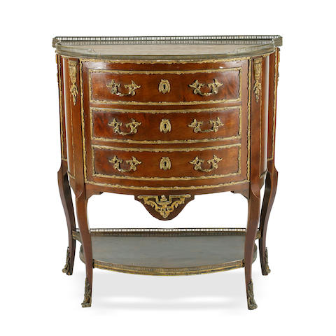 A Transitional style mahogany and marble topped commode