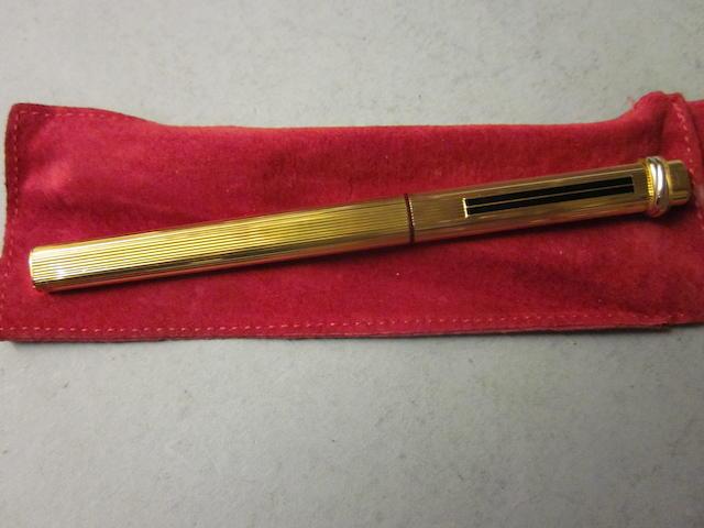 Cartier: A gold plated ball point pen,