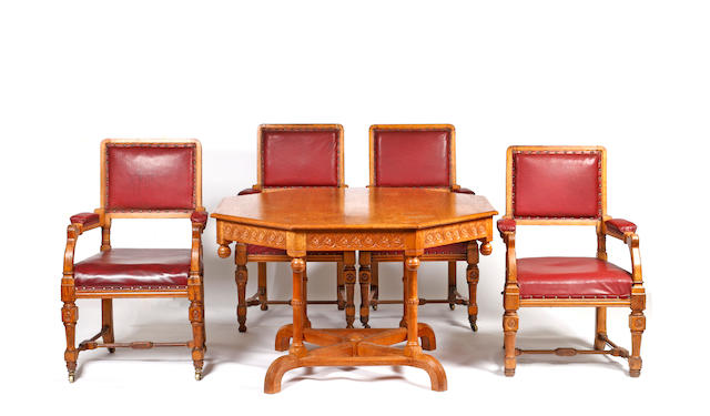 A late Victorian oak octagonal centre table and a set of four similar elbow chairs in the Aesthetic taste,