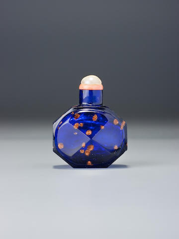 A faceted sapphire-blue 'aventurine'-splashed glass snuff bottle Imperial glassworks, Beijing, 1720–1760