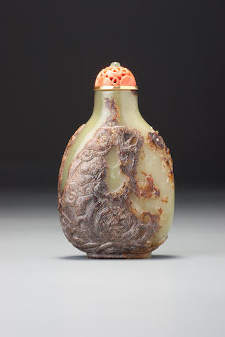A pale green nephrite pebble-material 'dragon' snuff bottle Master of the Rocks school, 1680–1800