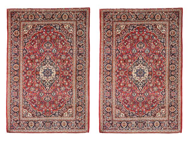 A matched pair of Kashan rugs   Iran, circa 1950 210cm x 140cm
