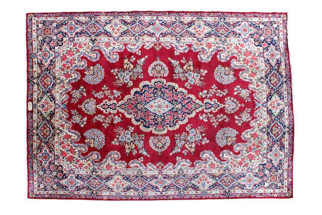 A Yaz/Kirman carpet signed Yazdan Parastan Iran, circa 1950 400cm x 304cm