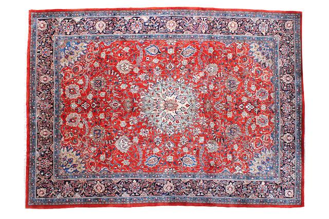 A Sarouk carpet  Iran, circa 1960. 363cm x 271cm