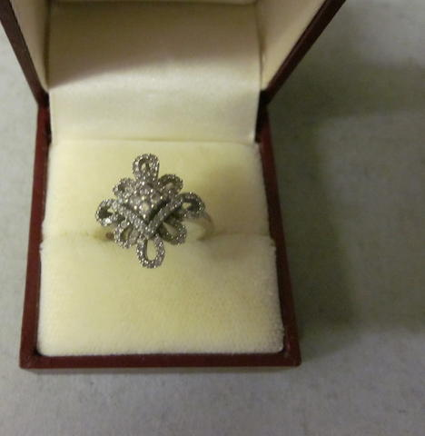 A continental diamond cluster ring,