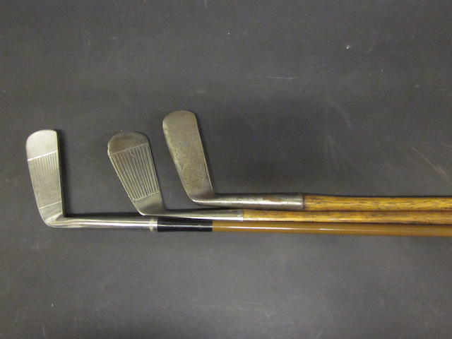 A pair of wooden shafted putters