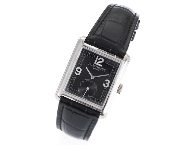 Patek Philippe. A fine 18ct white gold manual wind wristwatch together with fitted box Ref:5014, Case No.4008108, Movement No. 1855786, Circa 1990