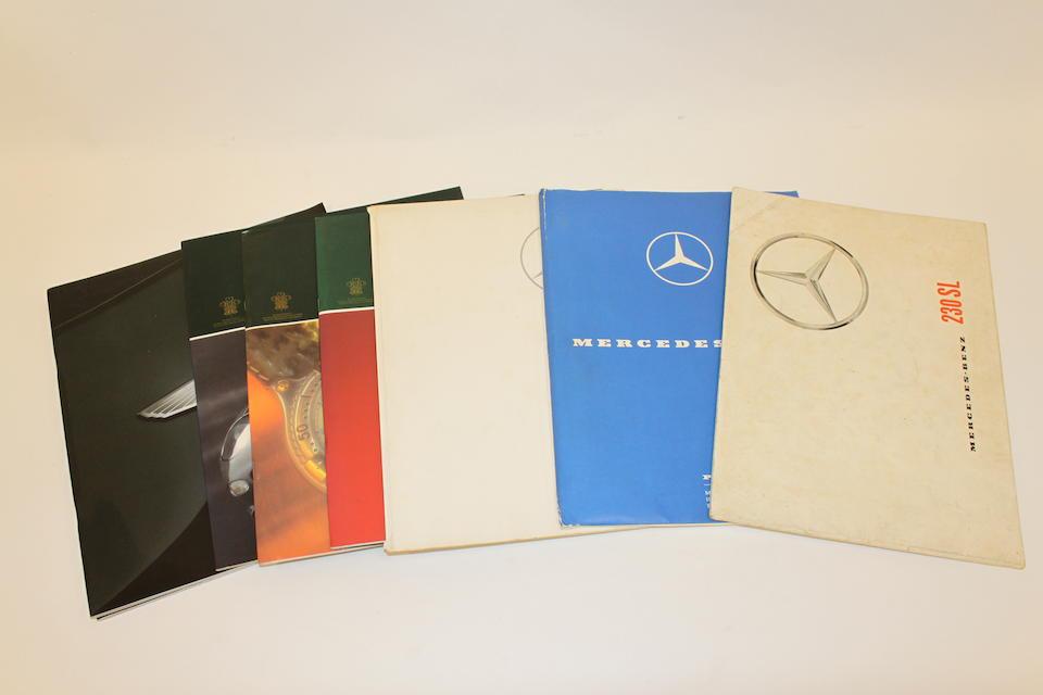 A collection of Aston Martin, Lotus, Lamborghini & Mercedes-Benz sales brochures