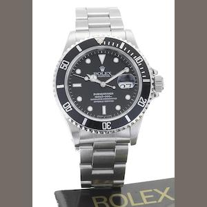 Rolex. A stainless steel automatic calendar bracelet watch Submariner, Ref:16610, Serial No.T859642, Sold 24th December 1997