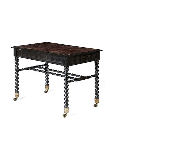 A mid-Victorian solid ebony and ebony veneered writing table Possibly Colonial