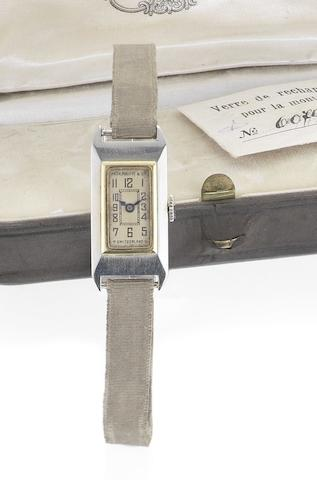 Patek Philippe. A fine two colour gold manual wind lady's wristwatch together with original numbered box, spare glass and Extract from ArchivesCase No.607997, Movement No.820164, Sold August 6th, Circa 1920